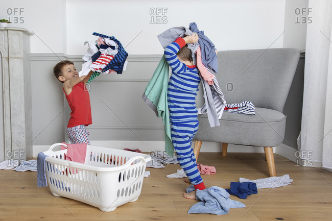 Boys throwing laundry at each other