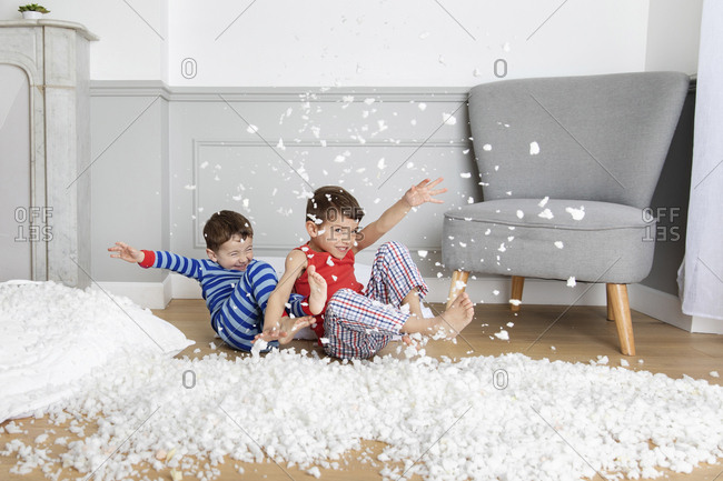 Children making mess with pillow stuffing