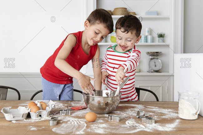 Brothers baking together at kitchen table