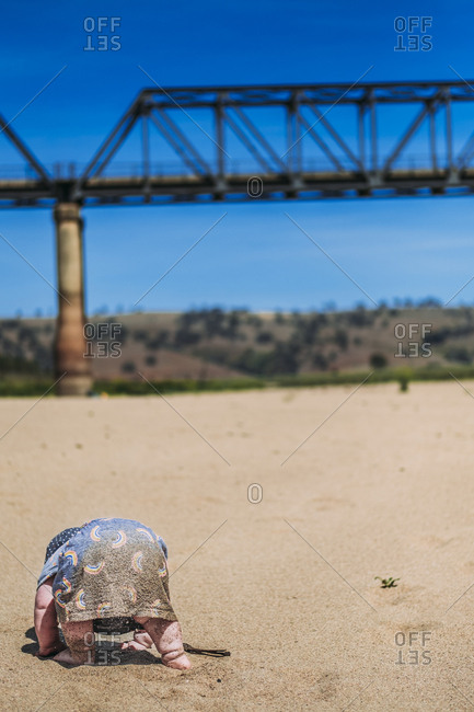 Toddler playing in sand at Murrumbidgee River