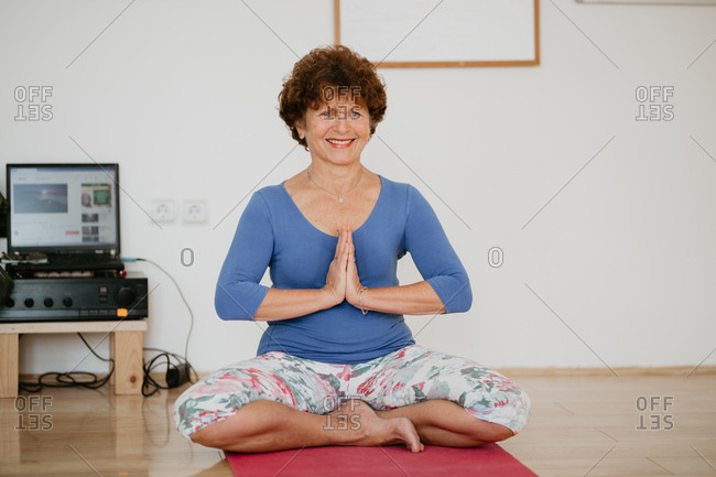 68 Years Old Woman Practicing Yoga