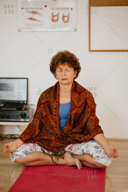 Portrait of a woman practicing yoga and meditating