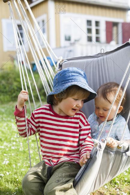 Siblings on hammock