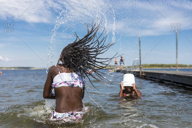 Girls playing in sea