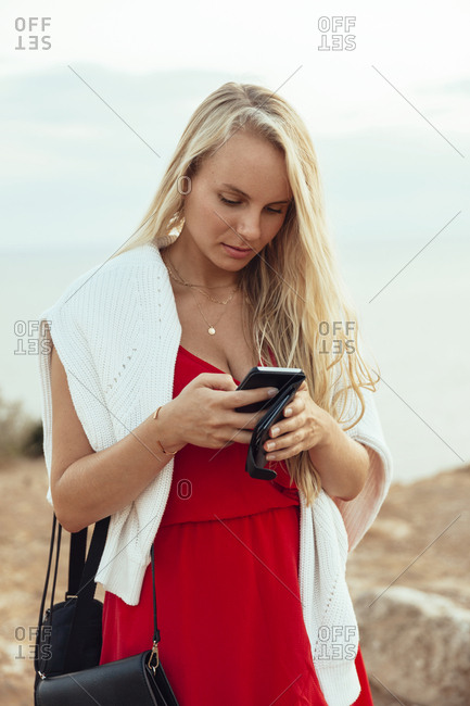 Beautiful blond woman with cell phone