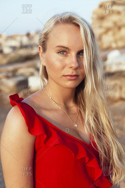 Portrait of beautiful blond woman wearing red dress