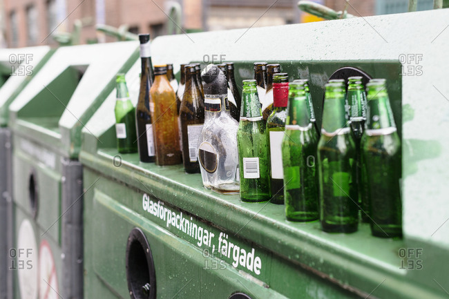 Empty bottles on recycling bin