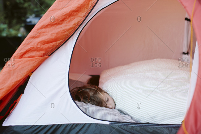 Boy sleeping in tent