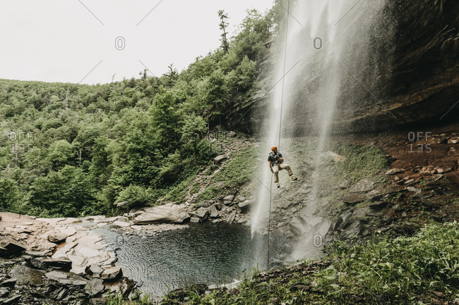 A man rappels a waterfall in the Catskills, New York, New England