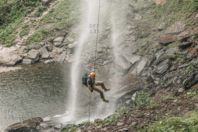 Man rappels Kaaterskill Falls in upstate New York, New England