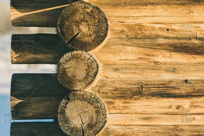 Sunny corner of a old historic log cabin