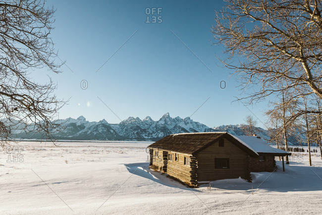 Jackson, Wyoming - January 13, 2019: Middle of nowhere Wyoming cabin on a sunny day in a field