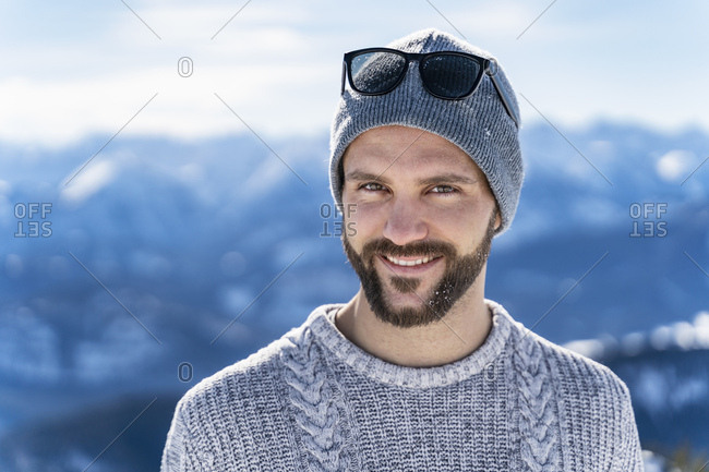 Germany- Bavaria- Brauneck- portrait of smiling man in winter in the mountains