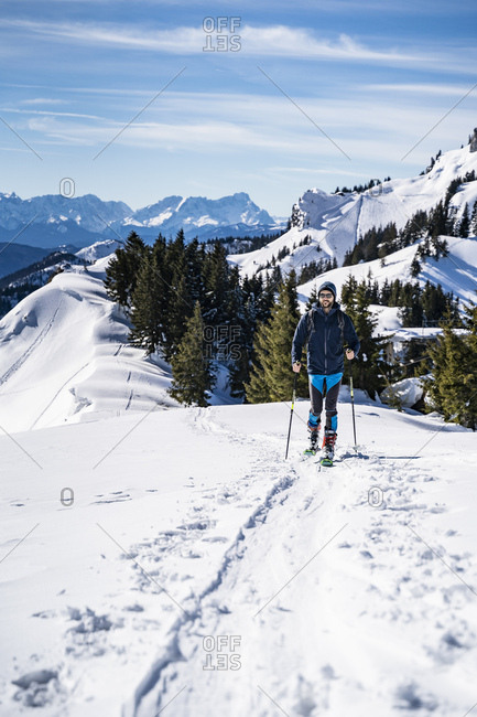 Germany- Bavaria- Brauneck- man on a ski tour in winter in the mountains