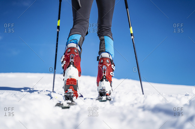 Legs of a man on a ski tour in winter in the mountains