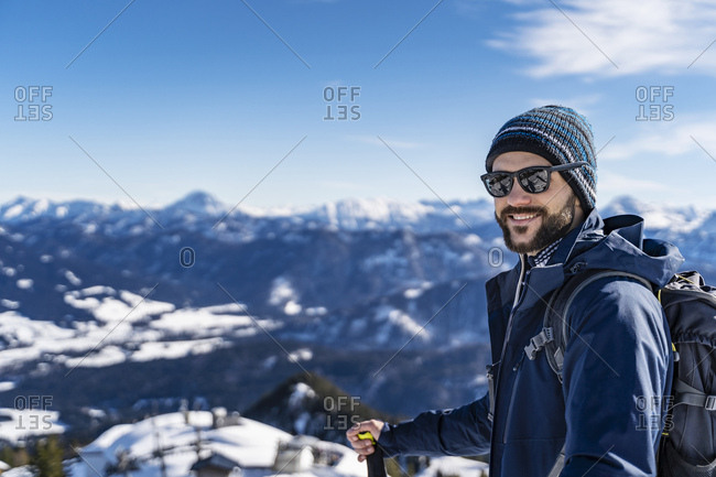 Germany- Bavaria- Brauneck- portrait of smiling man on a ski tour in winter in the mountains