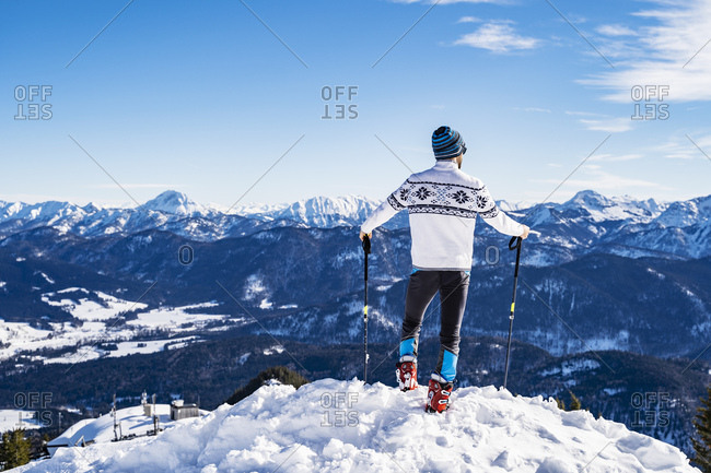 Germany- Bavaria- Brauneck- man in winter standing on mountaintop