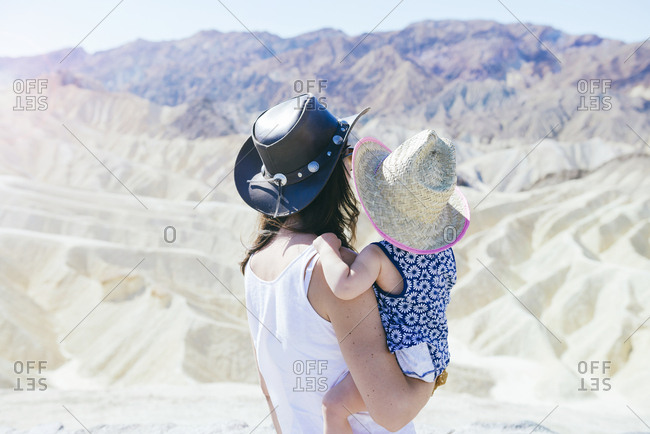 USA- California- Death Valley National Park- Twenty Mule Team Canyon- back view of mother and baby girl