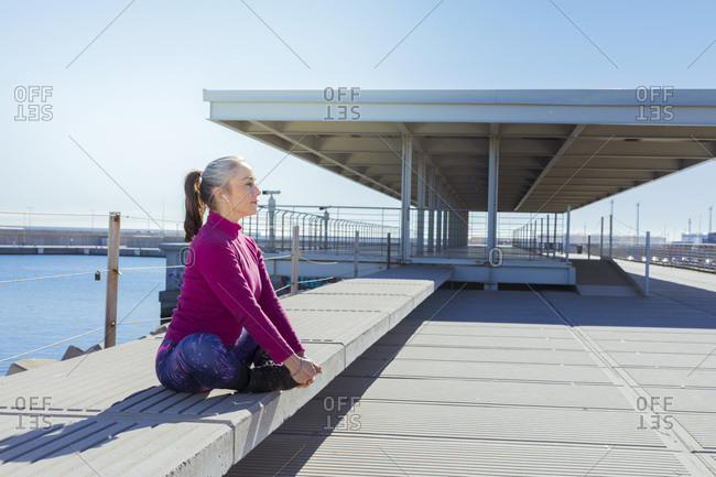 Sportive mature woman during stretching