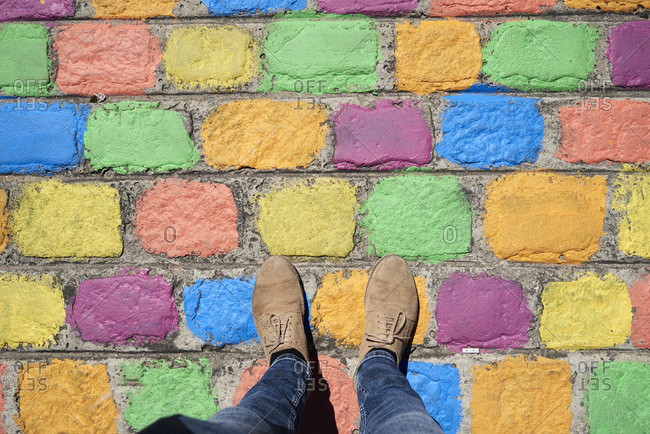 Argentina- Buenos Aires- La Boca- point of view shot of man standing on colorful pavement