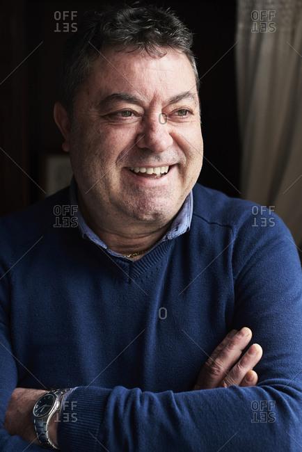 Portrait of smiling senior man wearing blue pullover