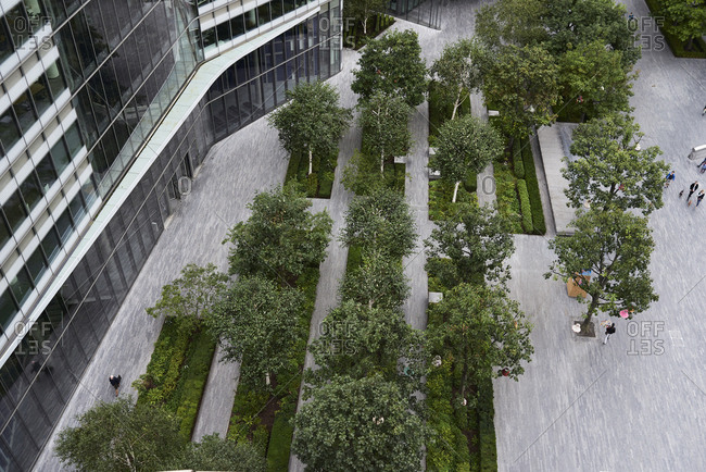 UK- London- top view of financial district with trees in courtyard