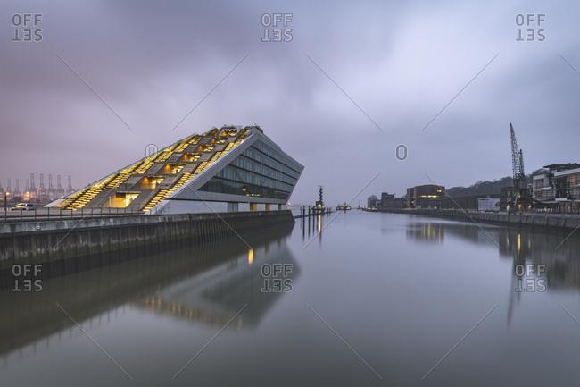 November 25, 2018: Germany- Hamburg- Altona- modern office building Dockland at dusk