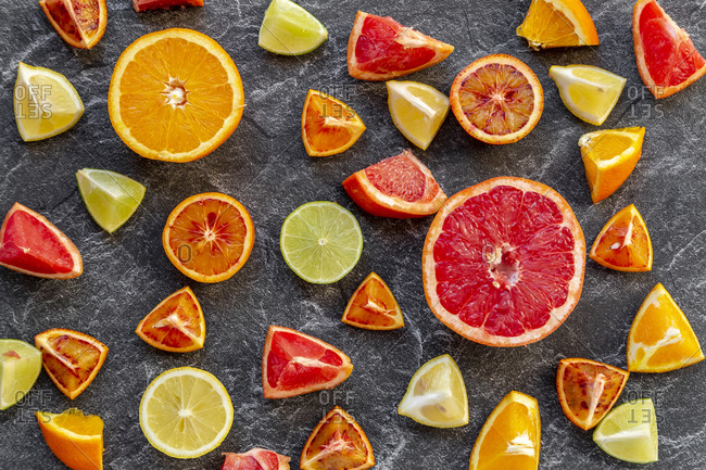 Sliced citrus fruits on slate