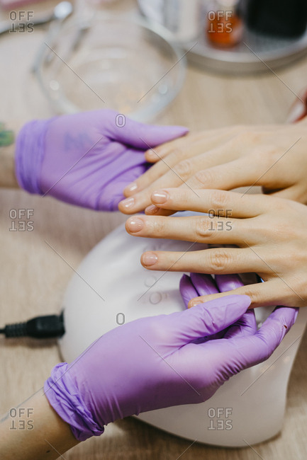 Close up of woman hands making manicure to a client at the salon. beauty services, beauty, health care