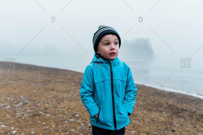 boy on a frozen beach.