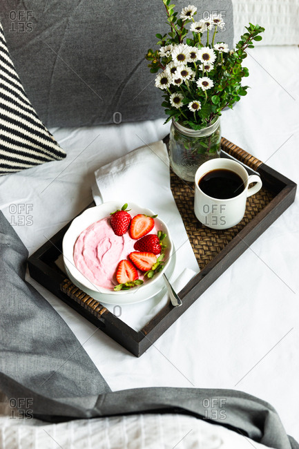 Pink smoothie bowl for breakfast in bed