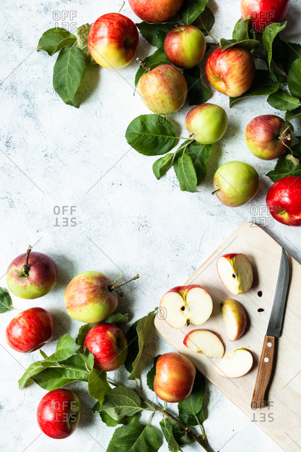 Apples sliced on a chopping board