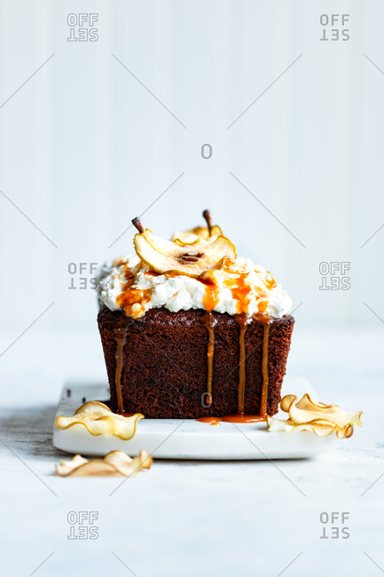 Pear spice cake with caramel drips with white background