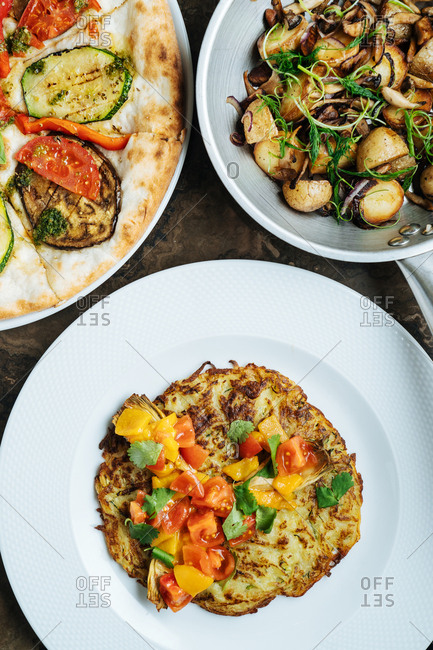 Zucchini dish, potato dish and pizza