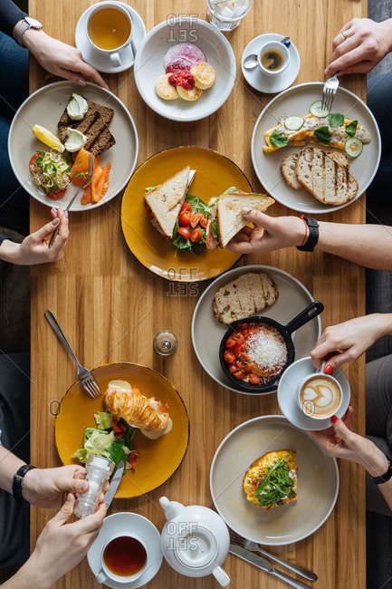 Overhead view of four people enjoying a meal together