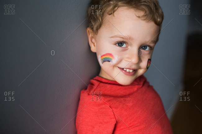 Toddler boy with rainbow face paint