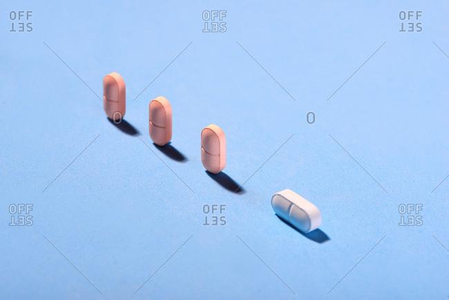 Pills on blue background.