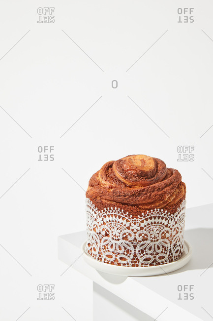 The composition of the fresh Easter cake, with beautiful lace on a bright table around a white background with space for text. Traditional easter dessert