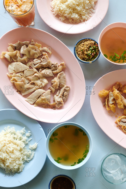 Khao Man Gai dish of boiled chicken served with a bowl of simple broth, ginger chili dip and rice