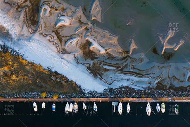 Aerial view of boats moored on a coast