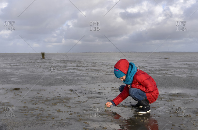 Germany- Lower Saxony- North Sea-     Hamburg Wadden Sea National Park- Neuwerk- low tide- girl playing in mudflat