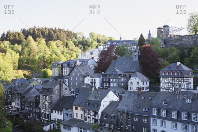 Germany- North Rhine-Westphalia- Eifel- Monschau- historic castle and typical half-timbered house with slates