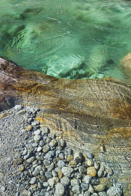 Switzerland- Ticino- Verzasca Valley- stones and rocks in clear turquoise waters of Verzasca river