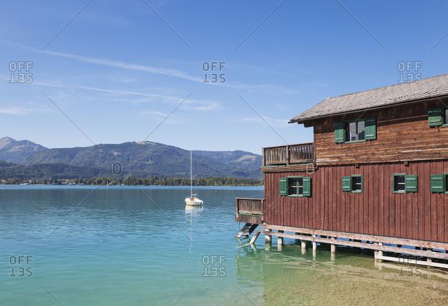 Austria- Alps- Salzburg- Salzkammergut- Salzburger Land- Wolfgangsee- boat and lake house in St. Wolfgang