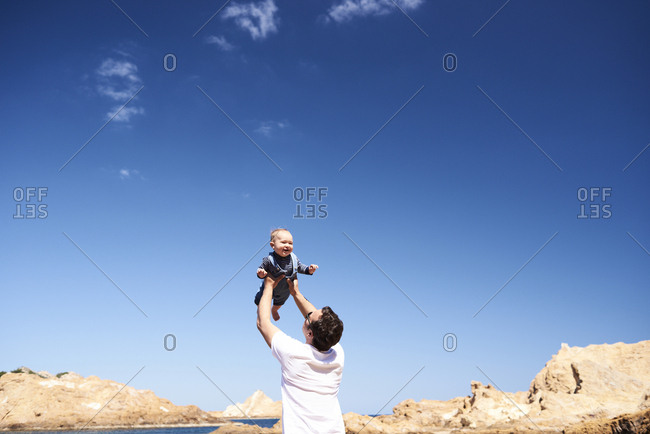 Spain- Menorca- father playing with little son on the beach