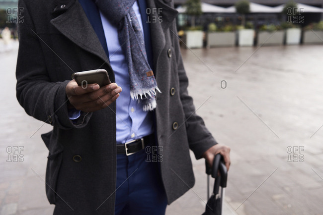 Hand of businessman holding mobile phone