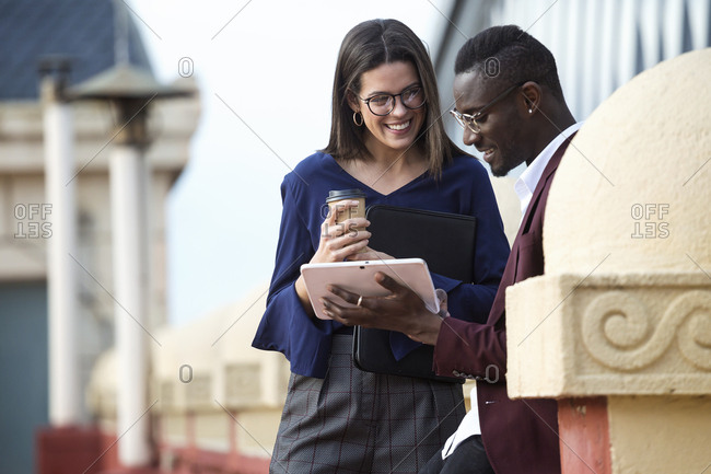 Businessman and woman having a meeting on a hotel terrace