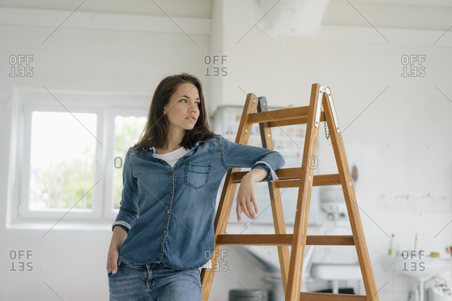 Pretty woman leaning on ladder