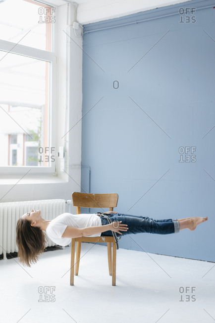 Woman hovering on chair