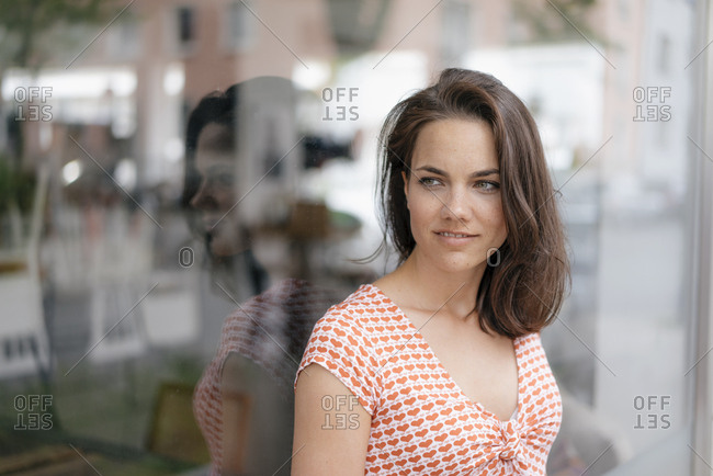 Portrait of a pretty woman- standing in front of window display